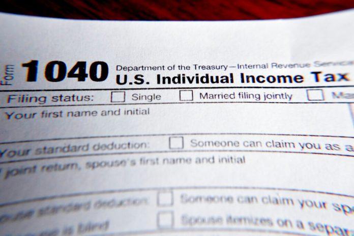 Lawrence's wife sentenced to jail for filing hundreds of false tax returns